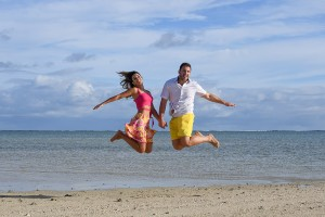 The couple leaps into the air on the beach at Nadi Fiji