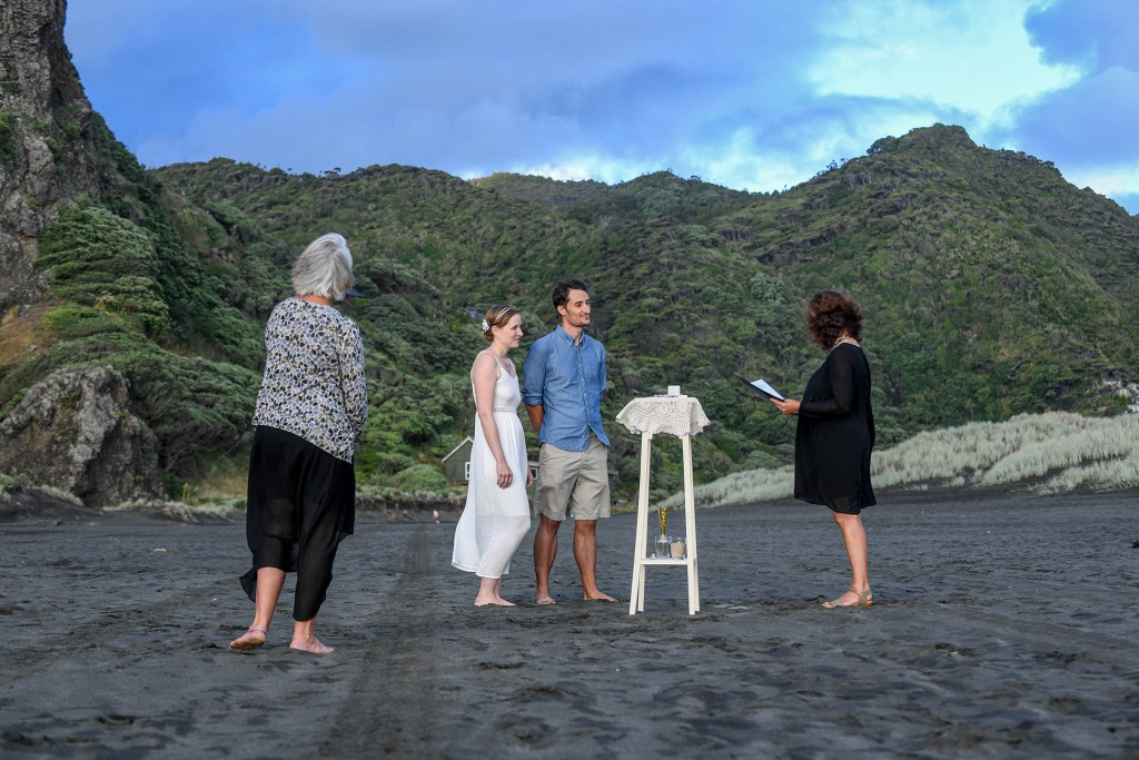 The marriage ceremony held on the black sand beach of Karekare