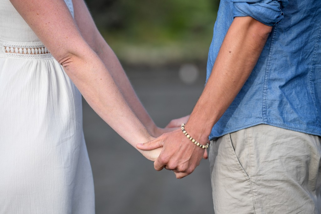 The couple holds hands as they exchange vows