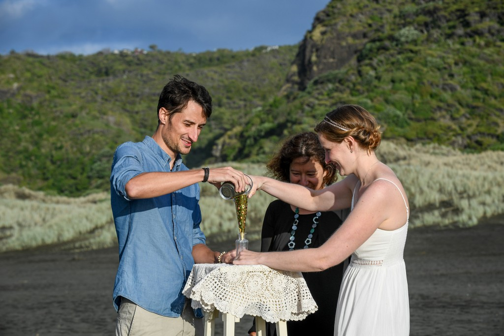The couple perform a sand vow ceremony.
