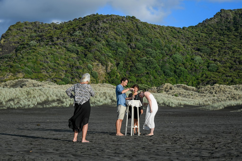 A long shot of the couple performing the sand ceremony