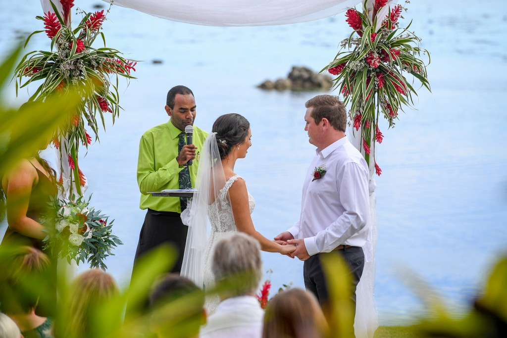 The groom receives the bride at the altar overlooking the Pacific ocean