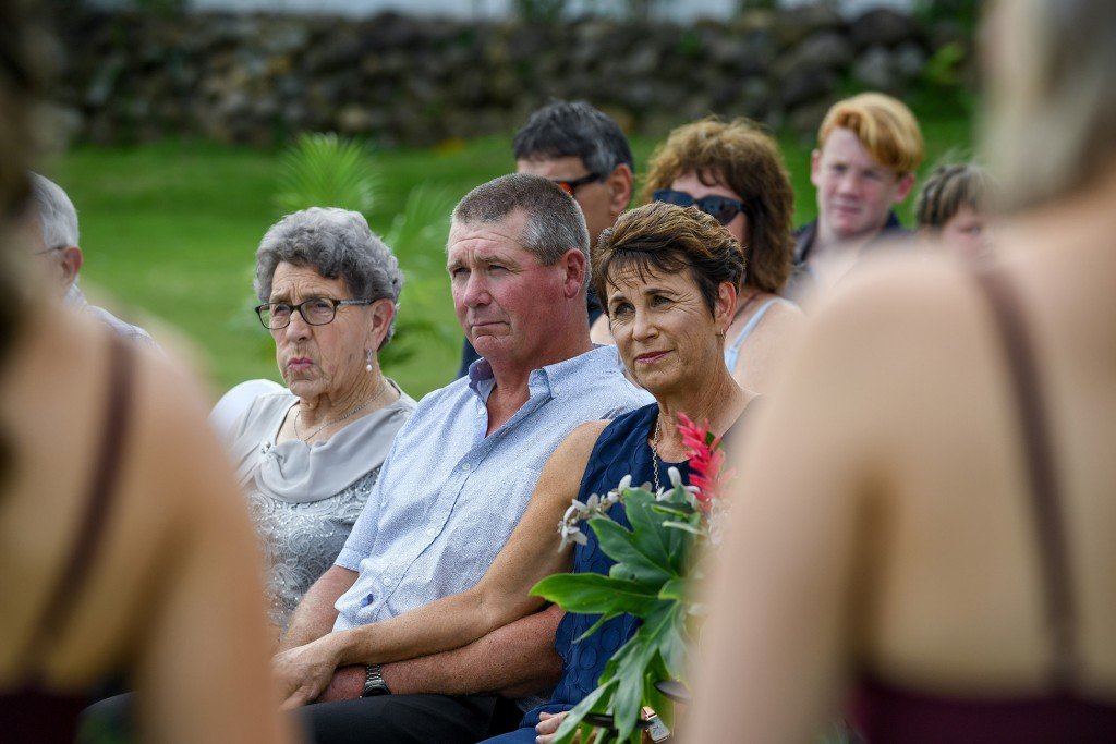 The parents of the groom watch the wedding vows passionately