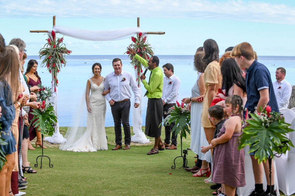 Guests celebrate the newly weds as they walk down the aisle
