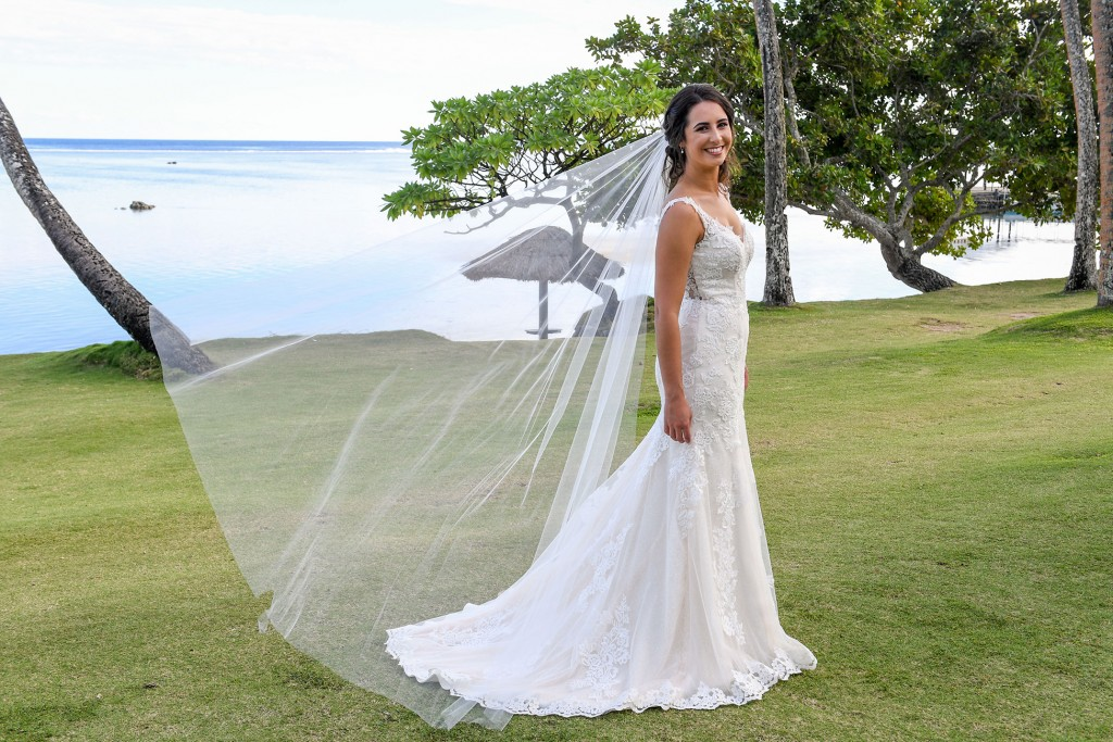 The bride's veil flies in the wind at Warwick Fiji