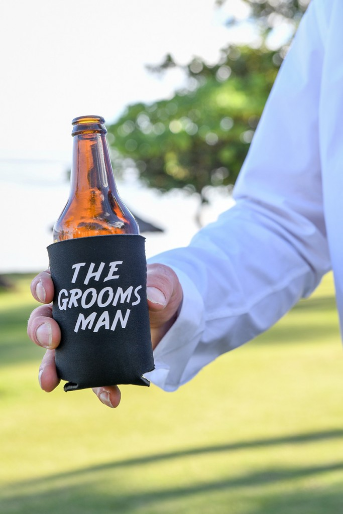 A closeup of the groomsman beer holder
