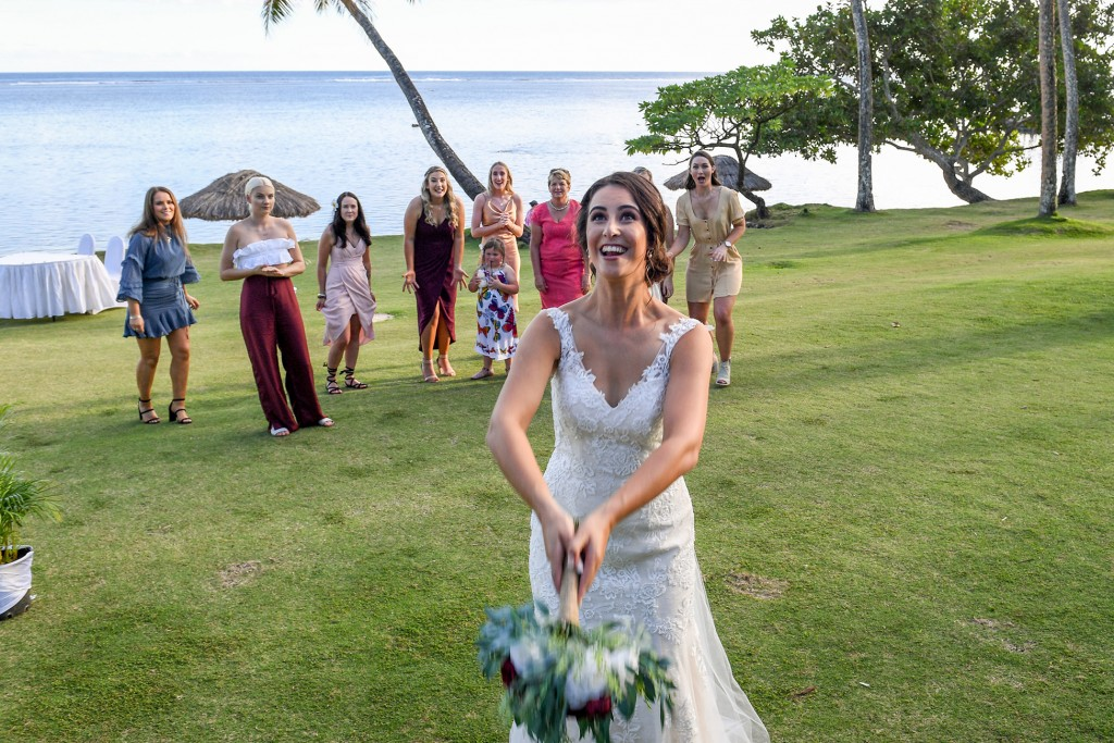 All the single ladies wait for the bride to toss the bouquet