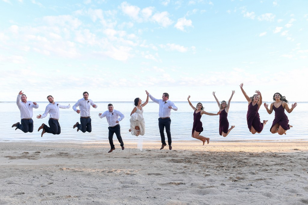 The bridal party leaps into the air at Warwick beach Fiji