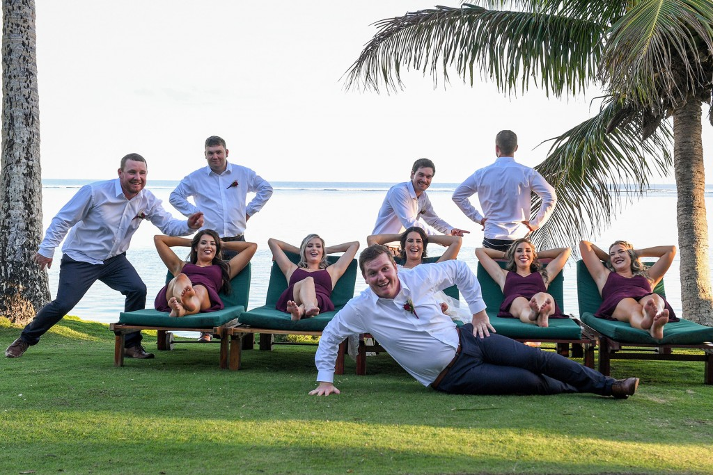 The bridal party goofs on the lawn at Warwick Fiji