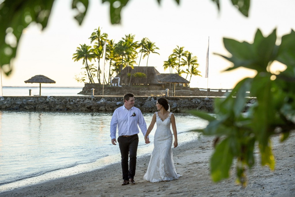 The newly weds stroll on the beach at Warwick Fiji