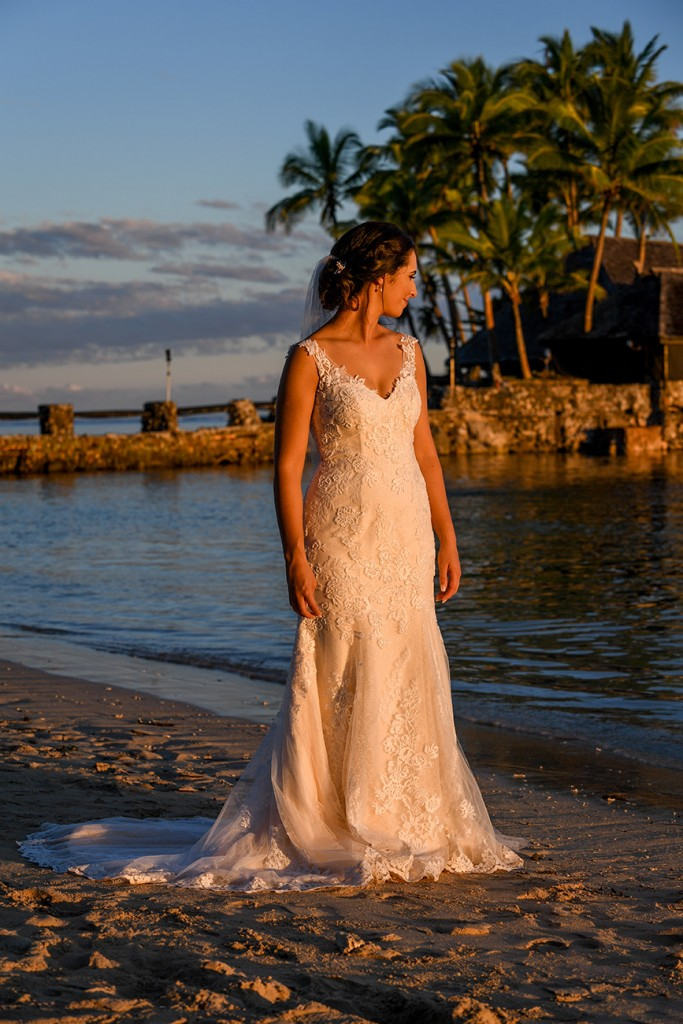 The golden sun glows off the bride at Warwick beach Fiji