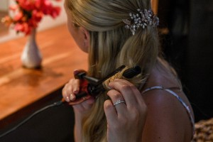 The bride curls her hair
