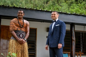 The groom and a Fiji warrior wait patiently for the bride