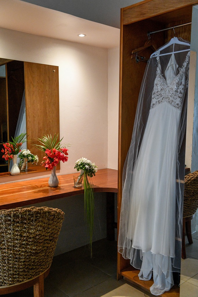 The Lilian West wedding gown draped in the reception before the wedding
