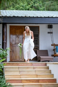 The bride walks down the stairs barefoot