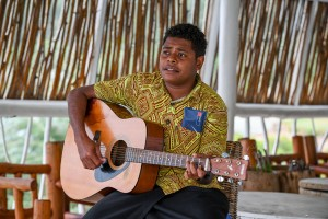 A Fiji serenader strums on his guitar during the wedding ceremony