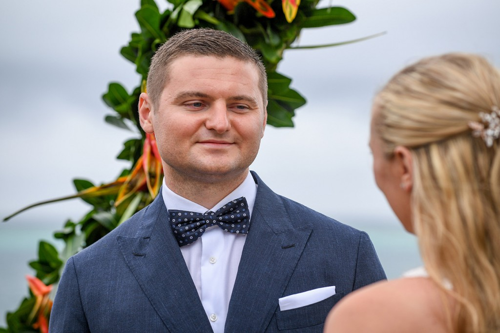 The groom adores the bride while at the altar