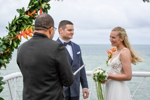 The couple shares their vows overlooking views of the Pacific ocean