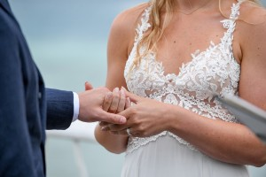 Closeup of the married couple hand in hand