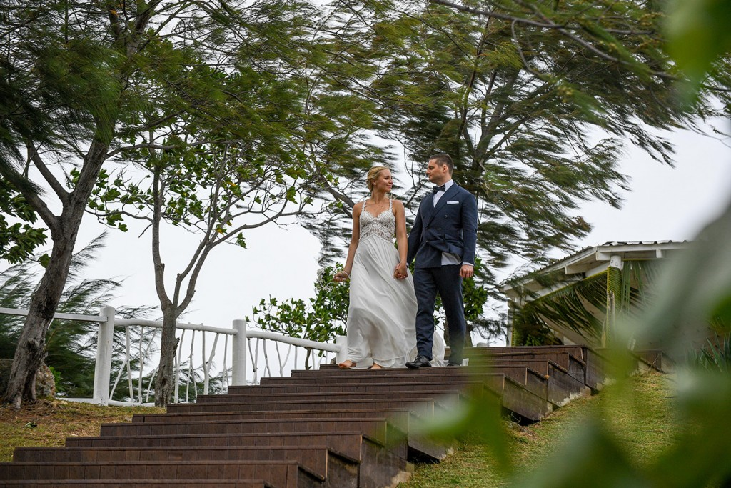 The newly weds hold hands as they walk down steps