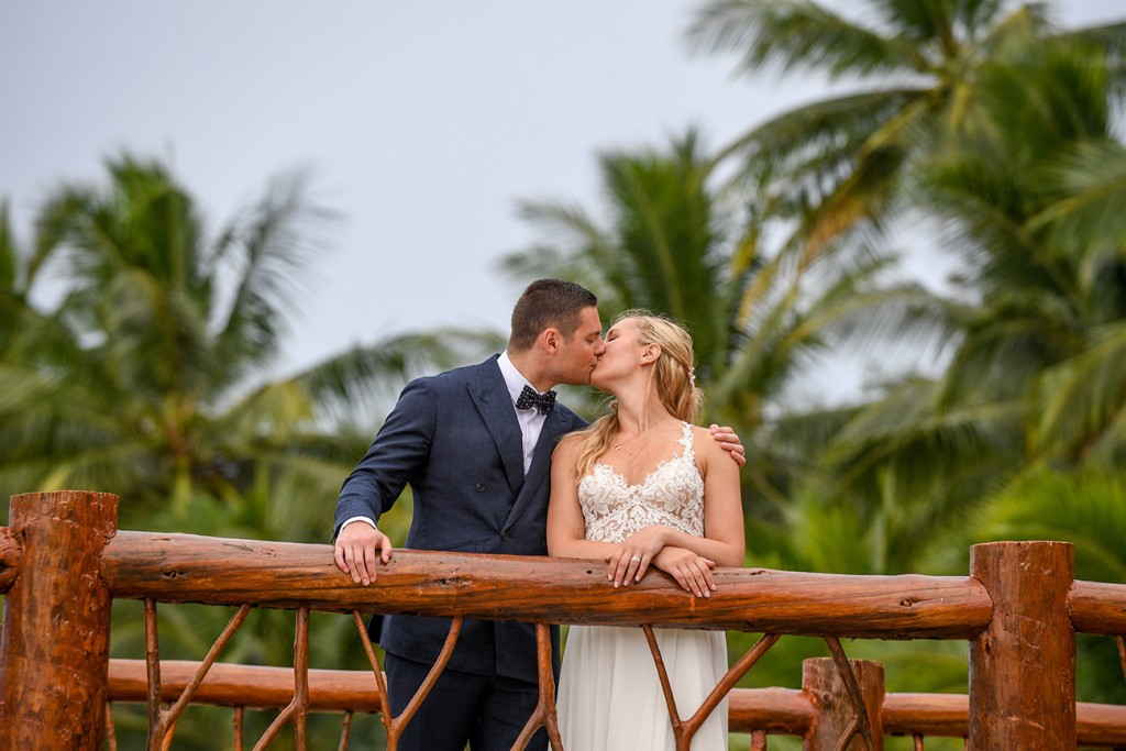 The newlyweds kiss on the pier at Tropica Island Resort