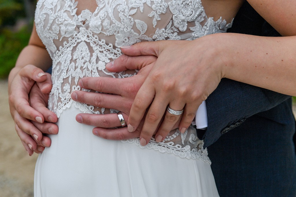 A closeup on the newlyweds rings