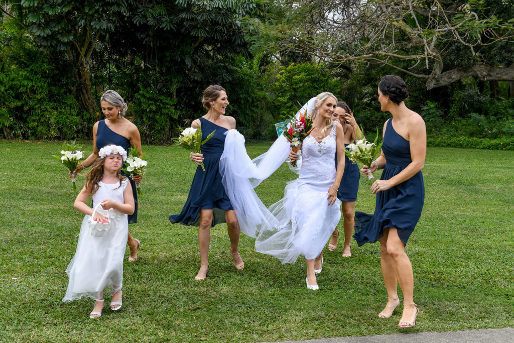 The bride dances with her bridesmaids as they head for the wedding ceremony