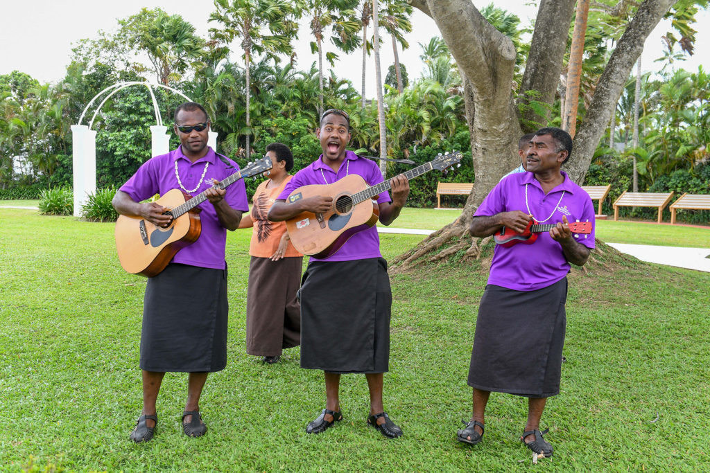 A traditional Fiji band plays the guitar and the ukulele