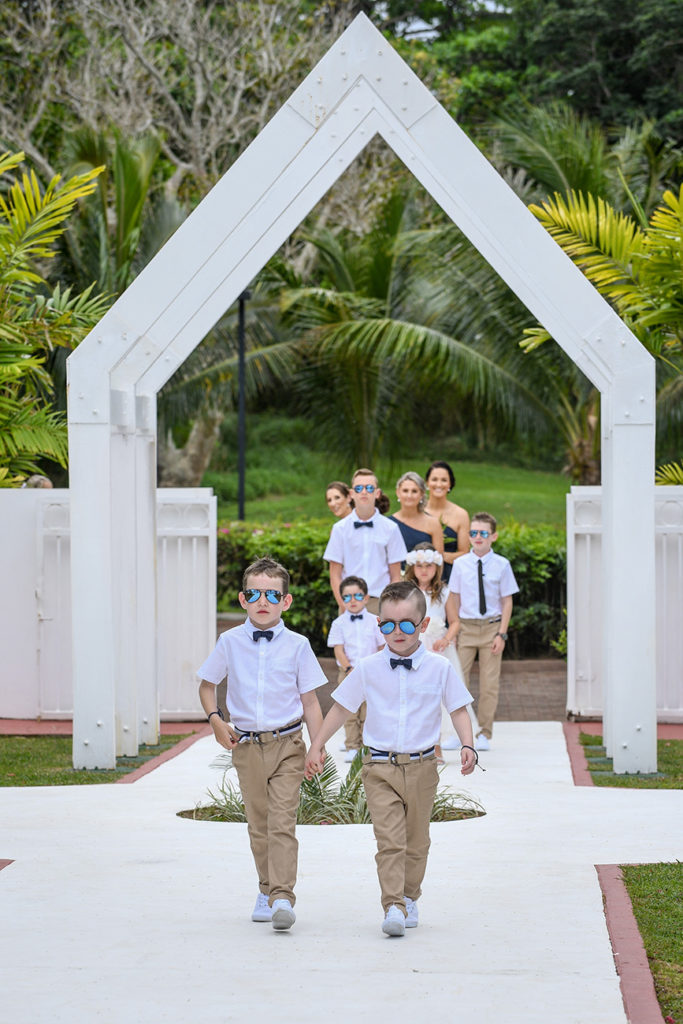 Best boys and the flower girls lead the aisle procession