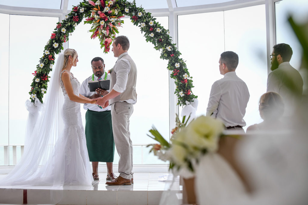 The newly weds take their vows at the altar