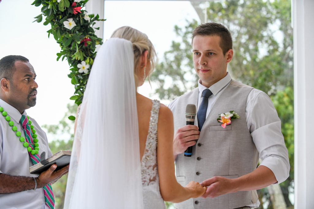 The groom says his vows to his stunning bride at Shangri La Fiji