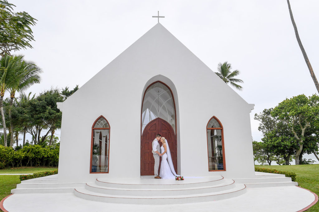 The newly weds pose in front of the magnificent white chapel at Shangri La Fiji