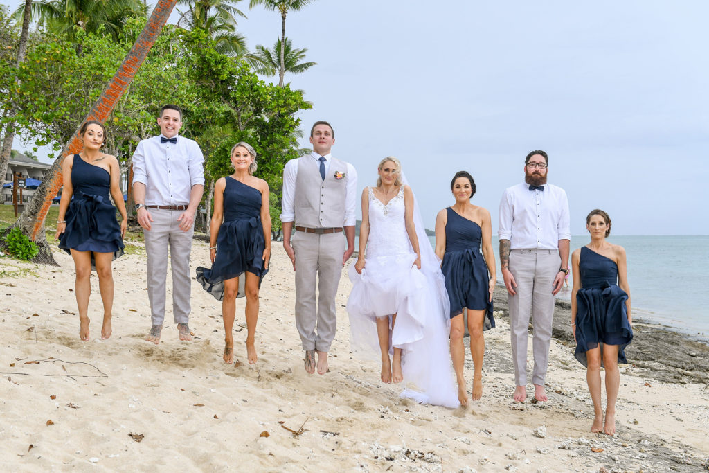 The bridal party jump in unison at the Shangri La Fiji