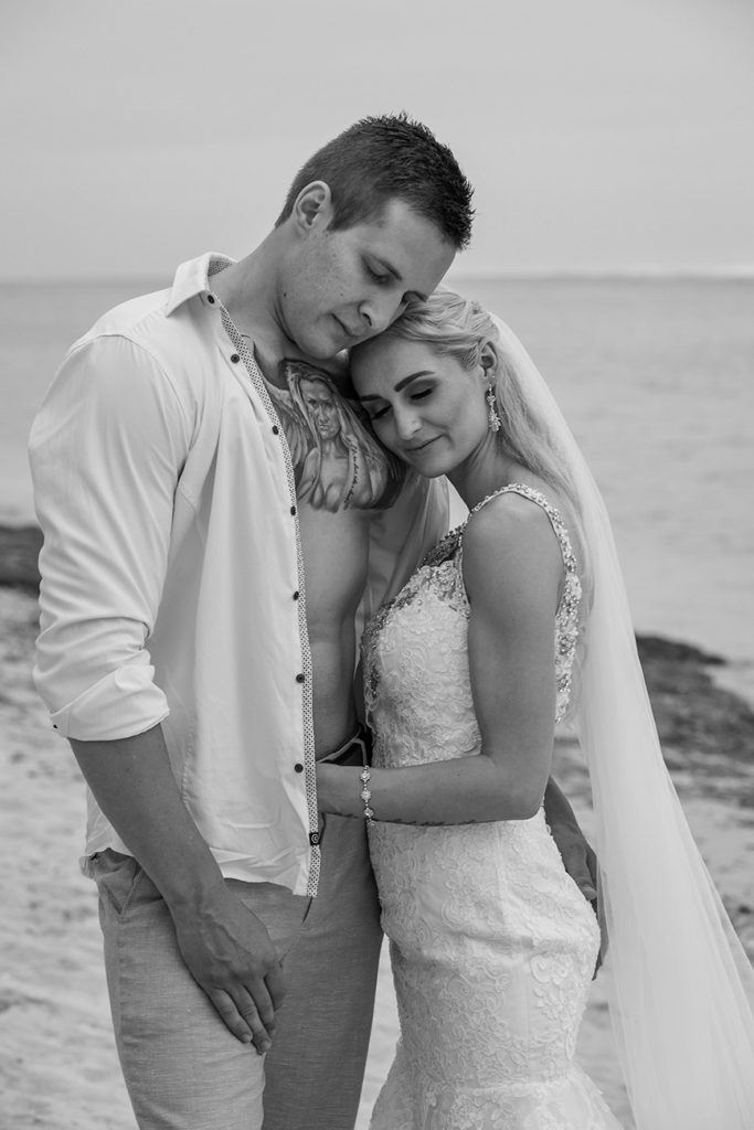 A monochrome image of the newly weds hugging while on Shangri La beach