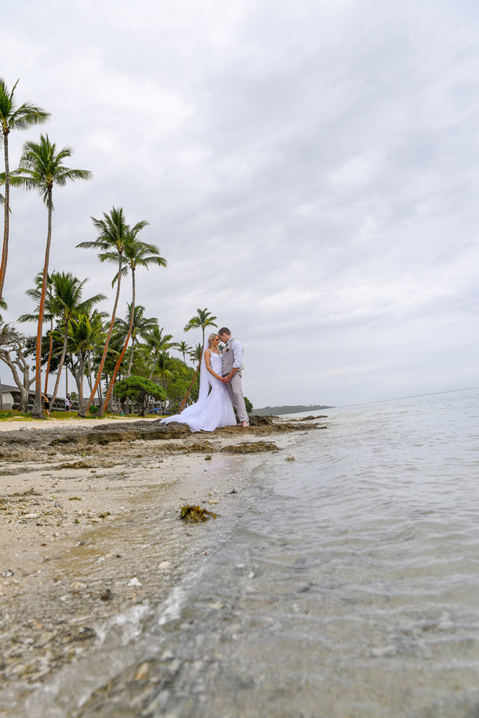 The bride and groom share an intimate moment on the shores of Shangri La Fiji