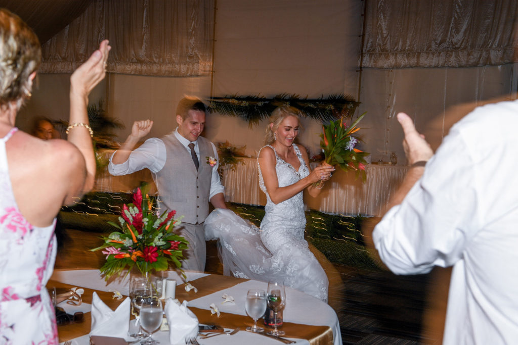 newly weds dance into the wedding ceremony