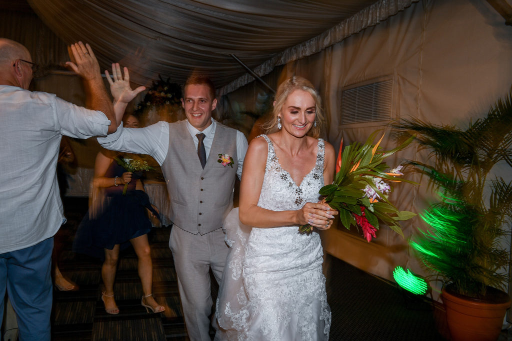 The newly weds dance while arriving at their wedding reception