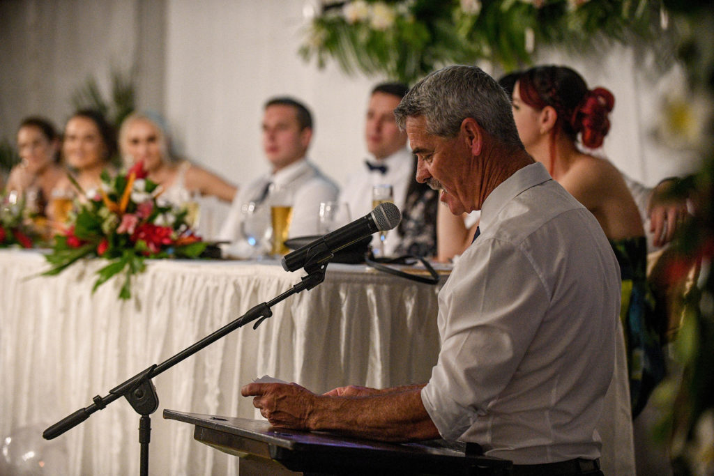 The bride's dad reads a speech to the newly weds