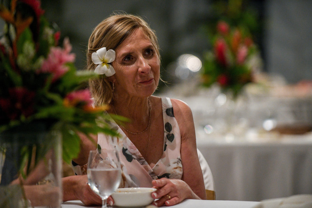A wedding guest listens attentively to the wedding speeches