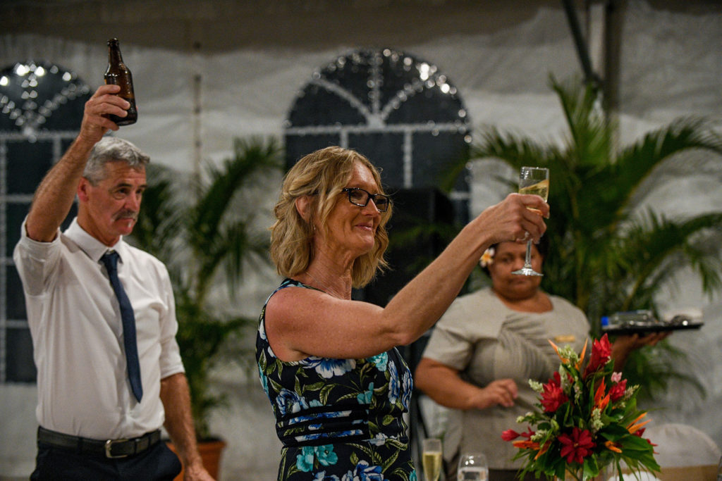 The mom of the bride raises a toast to the newly weds