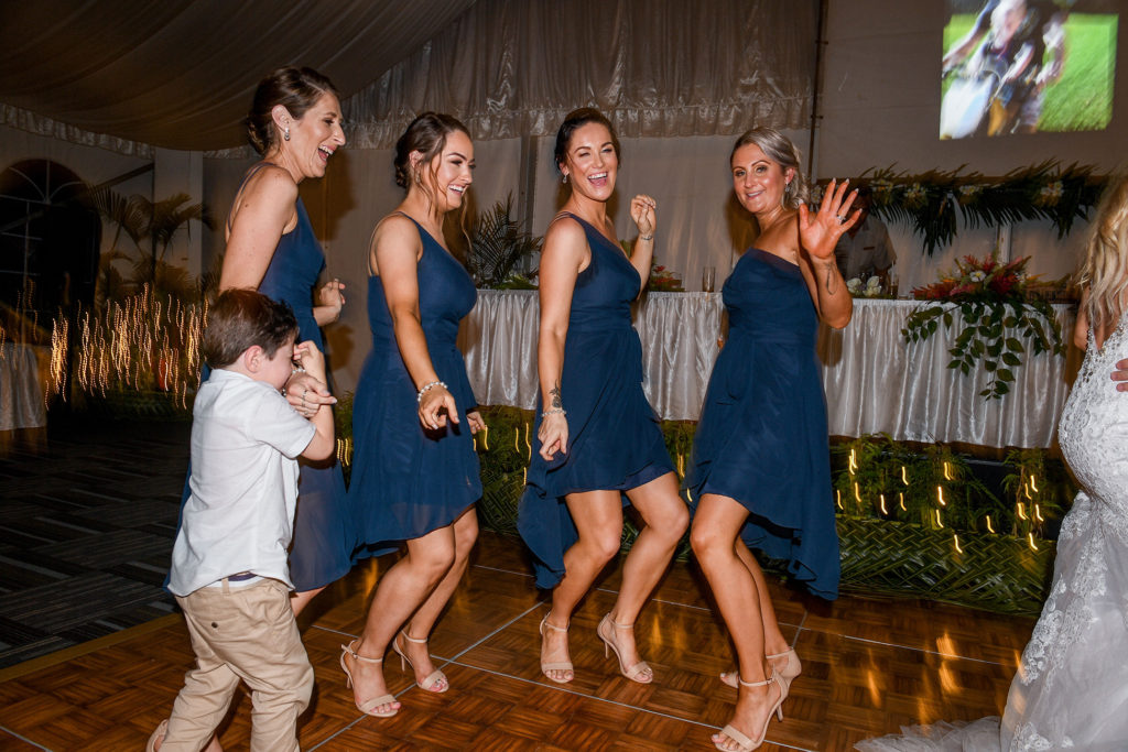 The bridesmaids dance at the wedding reception