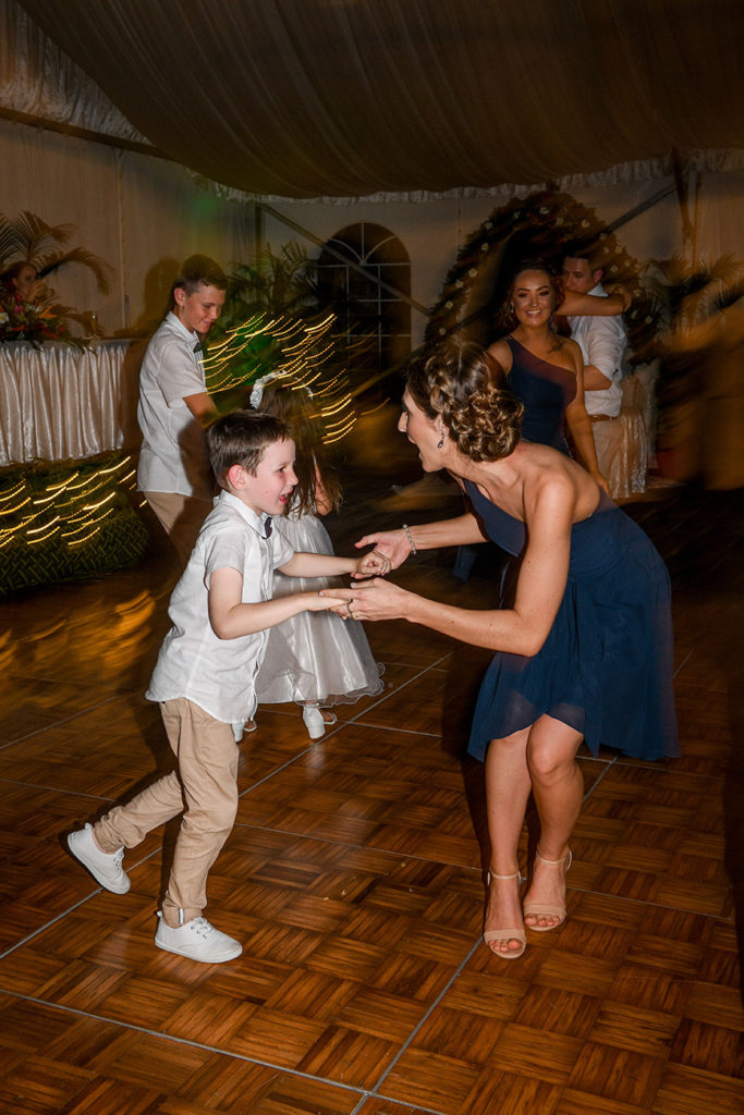 One of the bridesmaids dances with the best boy at the wedding reception