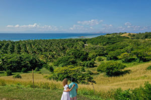 The loving couple stares into the rolling green hills of Malolo Island