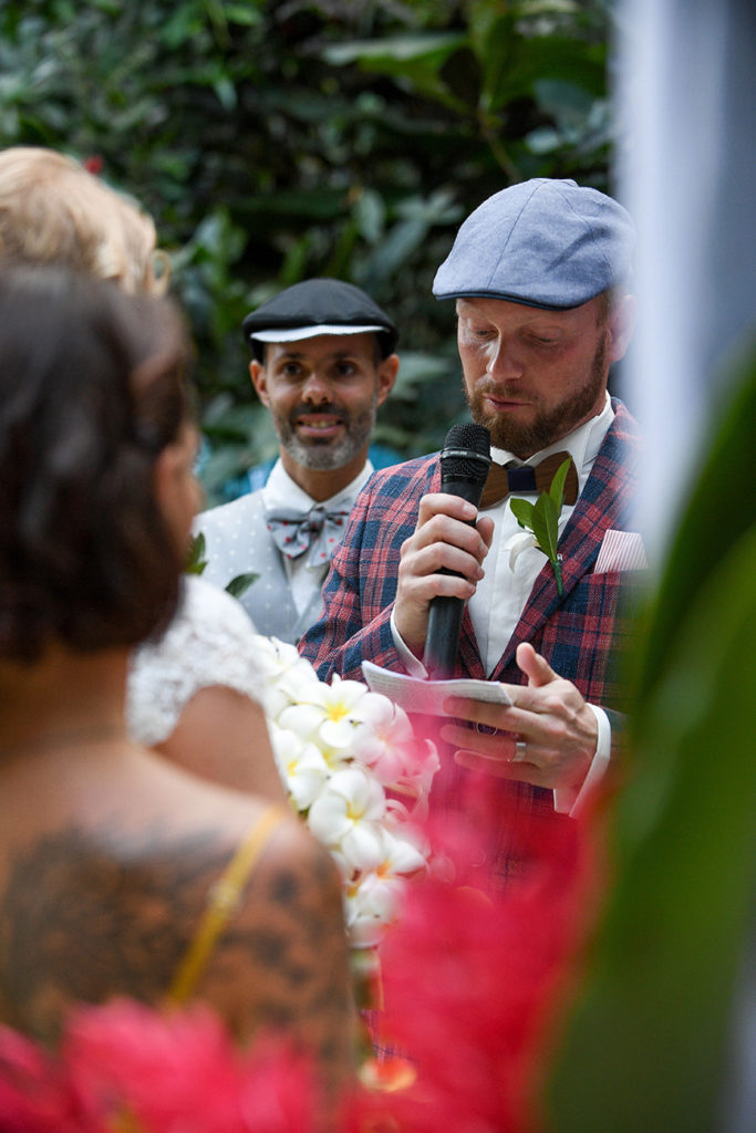 The groom reads his vows to the bride