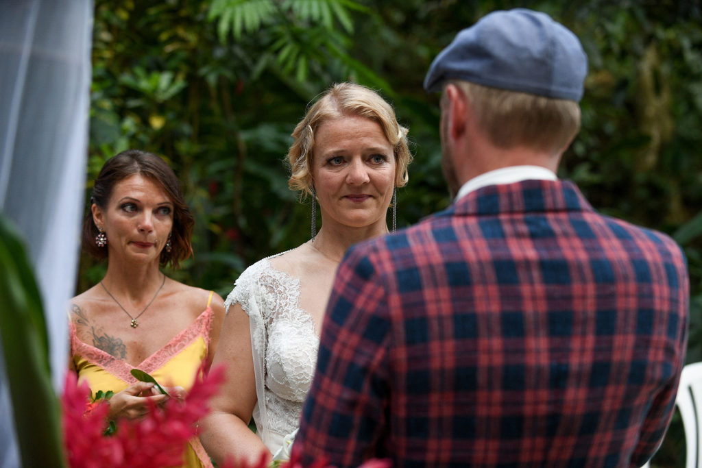 The bride watches teary-eyed as the groom reads his vows