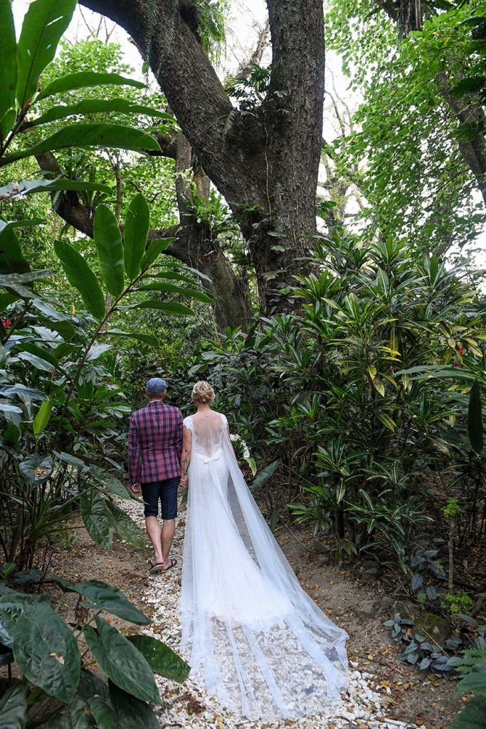 The newly weds stroll under the tropical Savusavu forest in Fiji