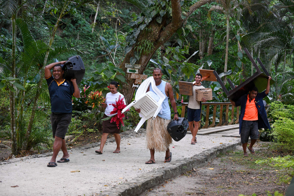 The Savusavu wedding party carries away all the wedding gear after the ceremony
