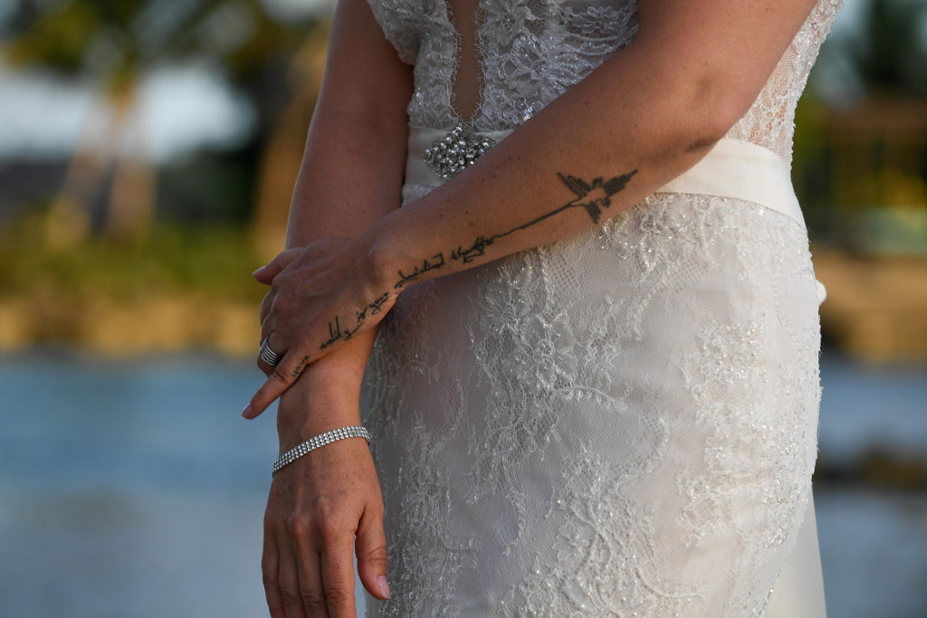 The bride's intricate tattoo on her forearm