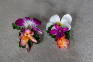 Simple and cute white and purple frangipani hairpins ready for the bride's hair