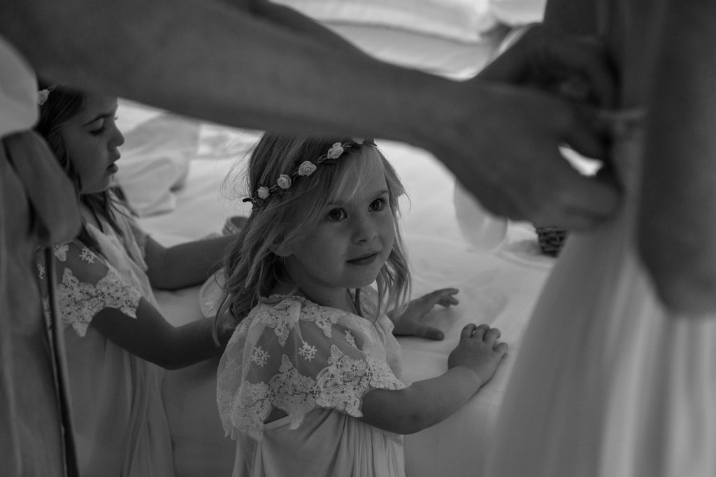 A monochrome photo of a cute little flower girl